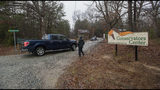 Conservators Center workers let a pickup truck enter property in Burlington, N.C., Monday, Dec. 31, 2018. An intern was cleaning an animal enclosure at the North Carolina wildlife center when a lion escaped from a nearby pen and attacked her, killing the young woman and sending visitors out of the zoo, authorities said. (Woody Marshall/The Times-News via AP)
