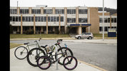 Bicycles are parked outside Tamaqua Area High School in Tamaqua, Pa., Friday, Jan. 4, 2019. Parents are going to court to block the Tamaqua Area School District from allowing teachers to carry guns in school. (AP Photo/Matt Rourke)