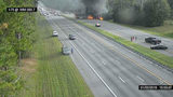 This image taken from a Florida 511 traffic camera and provided by the Alachua County Fire Rescue, shows a fiery crash along Interstate 75, Thursday, Jan. 3, 2019, about a mile south of Alachua, near Gainesville, Fla. Highway officials say six people have died after a crash and diesel fuel spill sparked a massive fire on a Florida interstate. (Alachua County Fire Rescue/Florida 511 via AP)