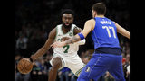 Boston Celtics guard Jaylen Brown (7) makes a dribble move against Dallas Mavericks forward Luka Doncic (77) during the first quarter of an NBA basketball game Friday, Jan. 4, 2019, in Boston. (AP Photo/Elise Amendola)