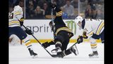 Boston Bruins' David Krejci, center, falls while battling Buffalo Sabres' C.J. Smith (49) and Evan Rodrigues (71) for the puck during the first period of an NHL hockey game in Boston, Saturday, Jan. 5, 2019. (AP Photo/Michael Dwyer)
