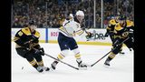 Boston Bruins' Kevan Miller (86) and Matt Grzelcyk (48) defends against Buffalo Sabres' Casey Mittelstadt (37) during the first period of an NHL hockey game in Boston, Saturday, Jan. 5, 2019. (AP Photo/Michael Dwyer)
