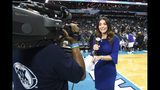 In this Wednesday, Dec. 19, 2018 photo, Ashley ShahAhmadi broadcasts from the baseline during a break in the Charlotte Hornets game against the Cleveland Cavaliers at the Spectrum Center in Charlotte, N.C. ShahAhmadi is in her first season with Fox Sports South as the host of the network's pre- and post-game coverage of Charlotte Hornets games. (David T. Foster III/The Charlotte Observer via AP)