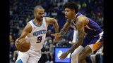 Charlotte Hornets guard Tony Parker (9) drives past Phoenix Suns forward Kelly Oubre Jr. in the first half during an NBA basketball game, Sunday, Jan. 6, 2019, in Phoenix. (AP Photo/Rick Scuteri)