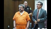 FILE - In this April 20, 2017 file photo, defendant Jason Dalton, left, who is charged with killing six people in-between picking up riders for Uber, stands with attorney Eusebio Solis during a hearing in Kalamazoo, Mich. Jury selection will begin on Jan. 3, 2019 after a prosecutor said he won't appeal a decision that keeps a lid on parts of a police interview. Kalamazoo County prosecutor Jeff Getting says it's time to bring the