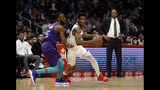 Los Angeles Clippers' Shai Gilgeous-Alexander, center, is defended by Charlotte Hornets' Kemba Walker, left, during the first half of an NBA basketball game Tuesday, Jan. 8, 2019, in Los Angeles. (AP Photo/Marcio Jose Sanchez)