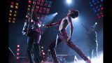 """This image released by Twentieth Century Fox shows Gwilym Lee, from left, Rami Malek and Joe Mazzello in a scene from """"Bohemian Rhapsody."""" On Thursday, Dec. 6, 2018, the film was nominated for a Golden Globe award for best motion picture drama. The 76th Golden Globe Awards will be held on Sunday, Jan. 6. (Alex Bailey/Twentieth Century Fox via AP)"""