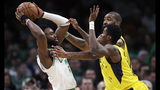 Boston Celtics guard Jaylen Brown, left, looks to pass as he is pressured by Indiana Pacers guard Edmond Sumner (5) and center Kyle O'Quinn (10), rear, during the second half of an NBA basketball game in Boston, Wednesday, Jan. 9, 2019. The Celtics defeated the Pacers 135-108. (AP Photo/Charles Krupa)