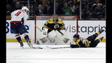 Boston Bruins defenseman Brandon Carlo, right, dives to prevent Washington Capitals left wing Alex Ovechkin (8) from scoring as Bruins goaltender Jaroslav Halak (41) protects the net during the second period of an NHL hockey game Thursday, Jan. 10, 2019, in Boston. (AP Photo/Elise Amendola)