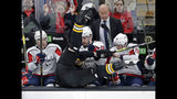 Boston Bruins defenseman Zdeno Chara is checked into the Washington Capitals bench during the first period of an NHL hockey game Thursday, Jan. 10, 2019, in Boston. (AP Photo/Elise Amendola)