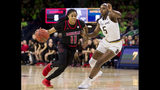 Louisville's Arica Carter (11) drives in next to Notre Dame's Jackie Young (5) during the first half of an NCAA college basketball game Thursday, Jan. 10, 2019, in South Bend, Ind. (AP Photo/Robert Franklin)