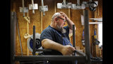 "Jack Lyons, a contractor working on massive rocket test stands for NASA, stands in his workshop while spending the furlough on his small side business making props for marching bands, in Madison, Ala., Tuesday, Jan. 8, 2019. ""They're trying to use people as bargaining chips, and it just isn't right,"" Lyons said. Unlike civil service workers who expect to eventually get back pay, Lyons doesn't know if he'll ever see a dollar from the shutdown period. (AP Photo/David Goldman)"