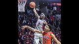 Mississippi's Terence Davis (3) dunks over Auburn's Chuma Okeke (5) during an NCAA college basketball game Wednesday, Jan, 9, 2019, in Oxford, Miss. (Bruce Newman/The Oxford Eagle via AP)