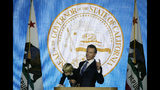 In this Monday, Jan. 7, 2019, photo, California Gov. Gavin Newsom holds his son Dutch while giving his address at his inauguration in Sacramento, Calif. Newsom gets his chance this week to show how he'll resolve a central tension in his platform: advancing expensive new programs while maintaining robust savings. (AP Photo/Eric Risberg)