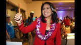 FILE - In this Nov. 6, 2018, file photo, Rep. Tulsi Gabbard, D-Hawaii, greets supporters in Honolulu. Gabbard has announced she's running for president in 2020. The 37-year-old Gabbard said in a CNN interview slated to air Saturday night that she will be formally announcing her candidacy within the week. (AP Photo/Marco Garcia, File)