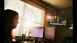 Katie Barron watches a rebroadcast of President Donald Trump's address to the nation on the partial government shutdown as she works from home in Madison, Ala., Wednesday, Jan. 9, 2019. Barron works for a private company not connected to the government but her husband is a National Weather Service meteorologist forced to work without pay because his job is classified as essential. (AP Photo/David Goldman)