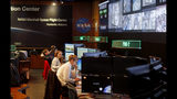 Workers monitor research operations aboard the International Space Station from NASA's Payload Operations Integration Center in Huntsville, Ala., Wednesday, Jan. 9, 2019. Of the roughly 800,000 federal employees facing deferred pay, more than half are deemed essential. (AP Photo/David Goldman)