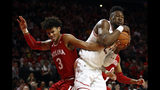 Maryland forward Bruno Fernando, right, of Angola, grabs a rebound over Indiana forward Justin Smith in the first half of an NCAA college basketball game, Friday, Jan. 11, 2019, in College Park, Md. (AP Photo/Patrick Semansky)
