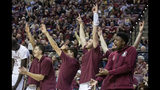 The Florida State bench reacts to a 3-point shot during the second half of the team's NCAA college basketball game against Miami in Tallahassee, Fla., Wednesday, Jan. 9, 2019. Florida State won 68-62. (AP Photo/Mark Wallheiser)