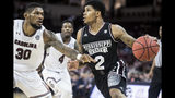Mississippi State guard Lamar Peters (2) is defended by South Carolina forward Chris Silva (30) during the second half of an NCAA college basketball game Tuesday, Jan. 8, 2019, in Columbia, S.C. South Carolina won 87-82. (AP Photo/Sean Rayford)