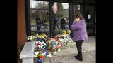 Mary Ann Doerzbacher wipes her eyes after placing flowers on a memorial outside the Davis Police Department for slain Davis Police Officer Natalie Corona, Friday, Jan. 11, 2019, in Davis, Calif. Corona, 22, who had been on the job only a few weeks was shot and killed, Thursday, by a suspect who opened fire as she was investigating a three-car crash. The suspect was later found dead from a self-inflicted gunshot, following a standoff with officers. (AP Photo/Rich Pedroncelli)