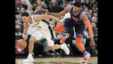 San Antonio Spurs' Bryn Forbes, left, and Oklahoma City Thunder's Paul George chase the ball during the first half of an NBA basketball game, Thursday, Jan. 10, 2019, in San Antonio. (AP Photo/Darren Abate)