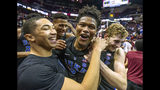 Duke guard Jordan Goldwire, left, and forward Jack White, right, celebrate with Cam Reddish after Reddish scored the game-winning jump shot against Florida State with less than a second left in the second half of an NCAA college basketball game in Tallahassee, Fla., Saturday, Jan. 12, 2019. Duke defeated Florida State 80-78. (AP Photo/Mark Wallheiser)
