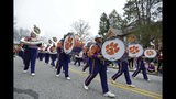 A band marches down the street during a parade honoring the Clemson Tigers, Saturday, Jan. 12, 2019, in Clemson, S.C., Clemson defeated Alabama 44-16 in the College Football Playoff championship game Monday Jan. 7. (AP Photo/Richard Shiro)