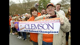 Jerry Halsell, right, and his grandson Nick Oliver, traveled from Paragould, Ark., to attend the parade held in honor of Clemson, Saturday, Jan. 12, 2019, in Clemson, S.C., The Tigers defeated Alabama 44-16 in the College Football Playoff championship game Monday Jan. 7. (AP Photo/Richard Shiro)