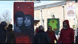 People look at exhibits at the Art Liberte the first traveling exhibition marking the 30 years anniversary of fall of the Berlin wall in the town of Plovdiv ahead of the opening ceremony of Plovdiv as one of European Capital of Culture, Bulgaria, Saturday, Jan. 12, 2019. Plovdiv is the first Bulgarian town named to celebrate the most prestigious cultural initiative of the European Union, along with the Italian city of Matera as the twin European Capital of Culture for 2019. (AP Photo/STR)