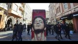 People walk past an exhibit showing the American singer Lou Reed which is part of the Art Liberte exhibition, the first traveling exhibition marking the 30 years anniversary of fall of the Berlin wall in the town of Plovdiv, Bulgaria, Saturday, Jan. 12, 2019. Plovdiv is the first Bulgarian town named to celebrate the most prestigious cultural initiative of the European Union, along with the Italian city of Matera as the twin European Capital of Culture for 2019. (AP Photo/STR)
