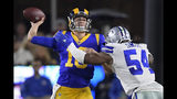 Los Angeles Rams quarterback Jared Goff passes under pressure from Dallas Cowboys middle linebacker Jaylon Smith during the first half in an NFL divisional football playoff game Saturday, Jan. 12, 2019, in Los Angeles. (AP Photo/Mark J. Terrill)
