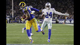 Los Angeles Rams running back Todd Gurley scores past Dallas Cowboys cornerback Chidobe Awuzie during the first half in an NFL divisional football playoff game Saturday, Jan. 12, 2019, in Los Angeles. (AP Photo/Marcio Jose Sanchez)