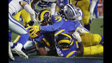 Los Angeles Rams running back C.J. Anderson scores against the Dallas Cowboys during the first half in an NFL divisional football playoff game Saturday, Jan. 12, 2019, in Los Angeles. (AP Photo/Marcio Jose Sanchez)