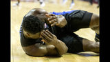 Duke forward Zion Williamson lays under the Duke basket injured after Florida State guard Trent Forres got his hand in Williamson's face in the first half of an NCAA college basketball game against Florida State in Tallahassee, Fla., Saturday, Jan. 12, 2019. (AP Photo/Mark Wallheiser)