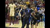 Duke guard Jordan Goldwire, right, forward RJ Barrett, center, and forward Jack White rush the court to celebrate with Cam Reddish after Reddish scored the game-winning jump shot against Florida State with less than a second left in the second half of an NCAA college basketball game in Tallahassee, Fla., Saturday, Jan. 12, 2019. Duke defeated Florida State 80-78. (AP Photo/Mark Wallheiser)