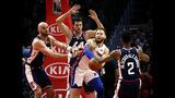 Detroit Pistons' Blake Griffin, second from right, passes the ball while pressured by Los Angeles Clippers' Danilo Gallinari, second from left, and Marcin Gortat, left, during the first half of an NBA basketball game Saturday, Jan. 12, 2019, in Los Angeles. (AP Photo/Ringo H.W. Chiu)