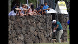 Children watch along the wall as Stewart Cink hits from a backyard along the first fairway during the third round of the Sony Open golf tournament Saturday, Jan. 12, 2019, at Waialae Country Club in Honolulu. (AP Photo/Matt York)