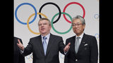 """FILE - This Nov. 20, 2013, file photo shows Japan Olympic Committee President Tsunekazu Takeda, right, and International Olympic Committee (IOC) President Thomas Bach, left, following a press conference in Tokyo. France's financial crimes office says International Olympic Committee member Takeda is being investigated for corruption related to the 2020 Tokyo Olympics. The National Financial Prosecutors office says Takeda, the president of the Japanese Olympic Committee, was placed under formal investigation for """"active corruption"""" on Dec. 10.(AP Photo/Junji Kurokawa, File)"""