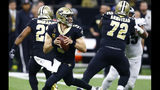 New Orleans Saints quarterback Drew Brees (9) works in the pocket against the Philadelphia Eagles in the first half of an NFL divisional playoff football game in New Orleans, Sunday, Jan. 13, 2019. (AP Photo/Butch Dill)