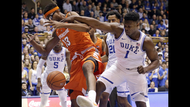 51879214c2f7 Duke s Zion Williamson (1) and Syracuse s Paschal Chukwu (13) chase a  rebound during the first half of an NCAA college basketball game in Durham