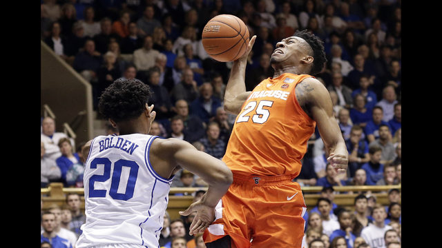 855f20c119ee Duke s Marques Bolden (20) defends while Syracuse s Tyus Battle (25) drives  to the basket during the first half of an NCAA college basketball game in  Durham ...