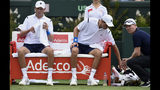 FILE - In this March 5, 2016 file photo, Jim Courier, far right, captain of the United States Davis Cup team, talks to doubles players Bob, left, and Mike Bryan while playing against Australia's Lleyton Hewitt and John Peers during their Davis Cup doubles match in Melbourne, Australia.The Bryan brothers have reunited as a doubles combination at a Grand Slam tournament and have opened with a 7-6 (4), 7-6 (1) win over Alex Bolt and Marc Polmans at the Australian Open in Melbourne, Australia, Wednesday Jan. 16, 2019. (AP Photo/Andrew Brownbill,File)