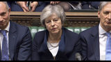In this grab taken from video, Britain's Prime Minister Theresa May listens to Labour leader Jeremy Corbyn speaking after losing a vote on her Brexit deal, in the House of Commons, London, Tuesday Jan. 15, 2019. British lawmakers have plunged Brexit into chaos and the U.K. politics into crisis by rejecting Prime Minister Theresa May's divorce deal with the European Union. The 432 to 202 vote in the House of Commons was widely expected but still devastating for May, whose fragile leadership is now under siege. (House of Commons/PA via AP)
