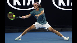 The Latest: Chair umpire gives Nadal warning at Aussie Open