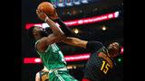 Boston Celtics guard Jaylen Brown (7) shoots as Atlanta Hawks forward Vince Carter (15) defends in the first half of an NBA basketball game against the on Saturday, Jan. 19, 2019, in Atlanta. (AP Photo/Todd Kirkland)