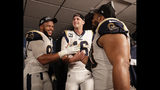 Los Angeles Rams defensive end Aaron Donald (99) Los Angeles Rams nose tackle Ndamukong Suh (93) and Los Angeles Rams quarterback Jared Goff (16) after overtime of the NFL football NFC championship game against the New Orleans Saints, Sunday, Jan. 20, 2019, in New Orleans. The Rams won 26-23.(AP Photo/David J. Phillip)