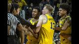 Matthews beats buzzer, No. 5 Michigan edges Minnesota 59-57