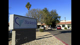 FILE - This Friday, Jan. 4, 2019, file photo shows Hacienda HealthCare in Phoenix. Two doctors who cared for an incapacitated woman who gave birth as a result of a sexual assault are no longer providing medical services at the long-term care center in Phoenix, Hacienda HealthCare said Sunday, Jan. 20. (AP Photo/Ross D. Franklin, File)