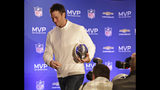 FILE - In this Feb. 2, 2015, file photo, New England Patriots quarterback Tom Brady leaves a news conference with his MVP trophy from Super Bowl XLIX, in Phoenix. A Super Bowl win over the Rams would give the 41-year-old a sixth ring, breaking a tie with Hall of Fame defensive end Charles Haley for the most all-time. ( John Samora/The Arizona Republic via AP, File)